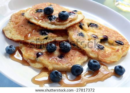 Blueberry pancakes with maple syrup.  Absolutely delicious! - stock photo