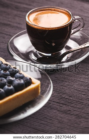 Blueberry pie and coffee on a dark background - stock photo