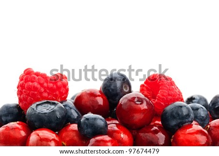 Blueberry, raspberry and cranberry. Mix ripe berries - stock photo