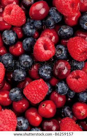 Blueberry, raspberry and cranberry patterned background material. Mix ripe berries - stock photo