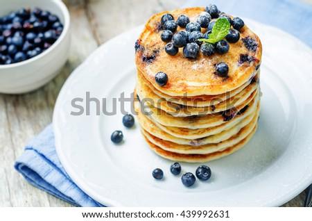 Blueberry Ricotta Pancakes on white wood background. toning. selective focus - stock photo