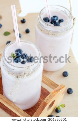 blueberry smoothie in a little milk bottle - stock photo