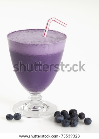 Blueberry smoothie on white background - stock photo