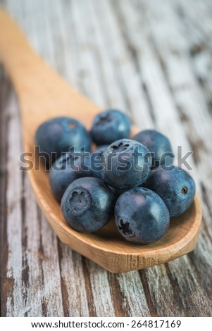 Blueberry spoon on wooden background