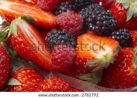 Blueberry, strawberry, raspberry and blackberry patterned background material. - stock photo