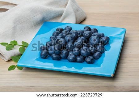Blueberry with leaves isolated on white background
