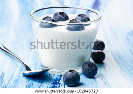 Blueberry yogurt in a glass - stock photo