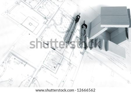 Blueprint wooden model house stock photo 12666556 shutterstock blueprint and wooden model of house malvernweather Choice Image