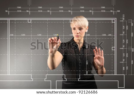 Blueprint design technical concept - girl drawing on screen - stock photo