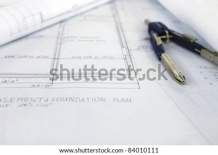 Blueprint drawing with compass - stock photo