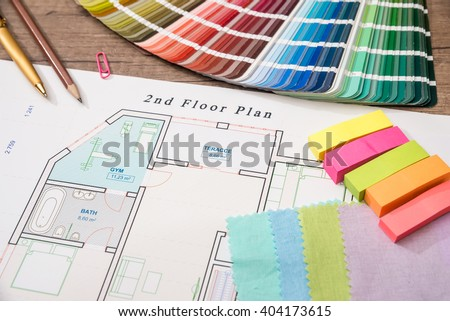 Blueprint of architectural drawing and color samples - stock photo