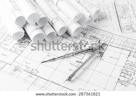 Blueprint plan of house building construction with drawing compass on the worktable - stock photo
