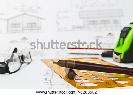 Blueprint with objects. Focus at pen. - stock photo