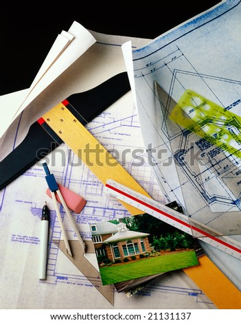 Blueprints and architect's tools with finished project photo - stock photo