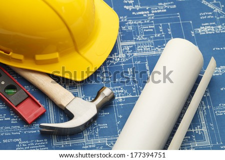 Blueprints and Construction Tools with Hard Hat. - stock photo