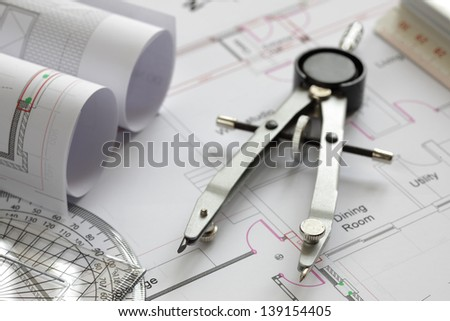 Blueprints and drawing tools concept for construction or development - stock photo
