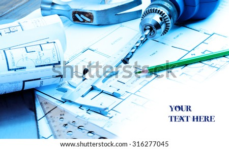 Blueprints and home renowation items with copyspace toned in blue - stock photo