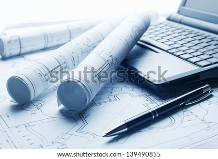 Blueprints and laptop - stock photo