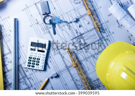 blueprints, calculator and laptop, construction and finance theme - stock photo