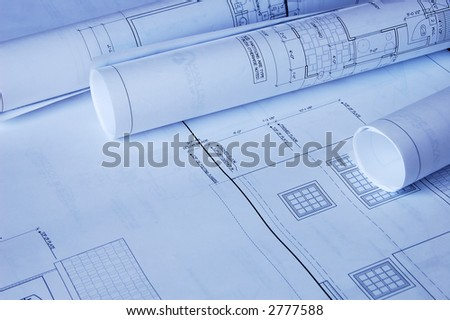 Blueprints of a house and rolls