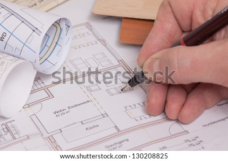 Blueprints of a house with drawing equipe. picture is toned