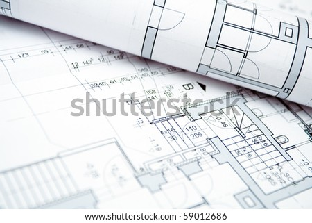 Blueprints of housing project, engineering workspace