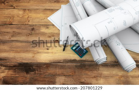 blueprints, pen and calculator on wooden table - stock photo