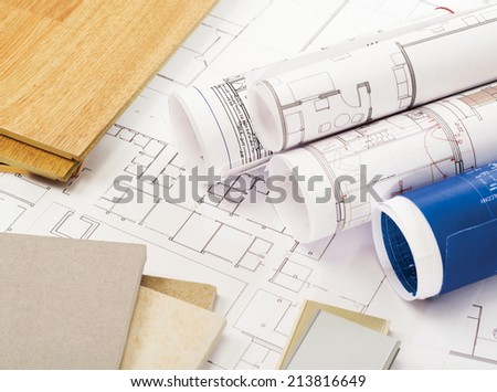 Blueprints, wood and stone samples - stock photo
