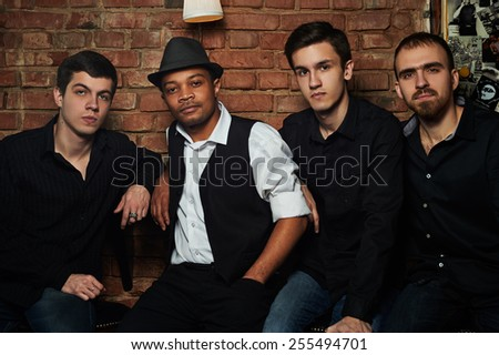 Blues band in nightclub with brick wall - stock photo