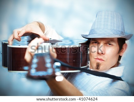 Bluesy musician holding his guitar