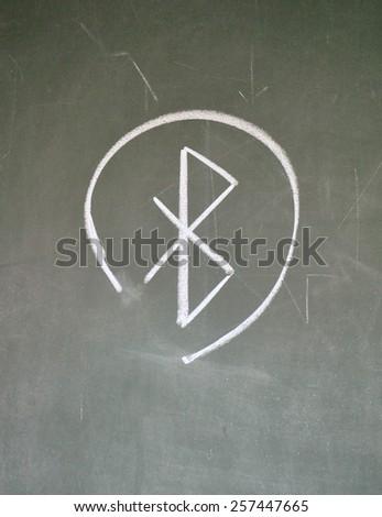 bluetooth sign on blackboard - stock photo