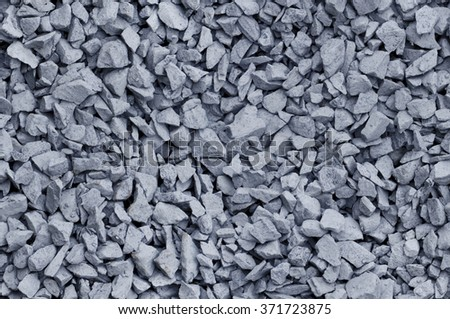 Bluish gray gravel used for construction fill, seamless background texture - stock photo