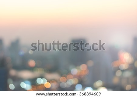 Blur abstract background aerial view Bangkok cbd downtown city night light colorful twilight skyline bokeh in warm vintage gold color tone: Central business district on electric train line over river  - stock photo
