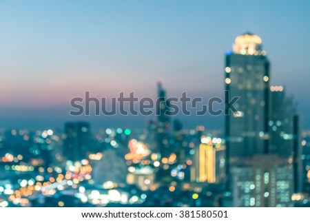 Blur abstract background aerial view Bangkok cbd downtown city night light colorful twilight skyline bokeh cool cyan vintage gold color tone: Central business district road traffic illumination glow - stock photo
