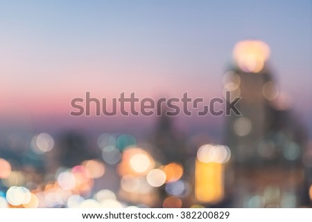 Blur abstract background aerial view Bangkok cbd downtown city night light colorful twilight skyline bokeh in warm vintage gold color tone: Central business district road traffic illumination glow - stock photo