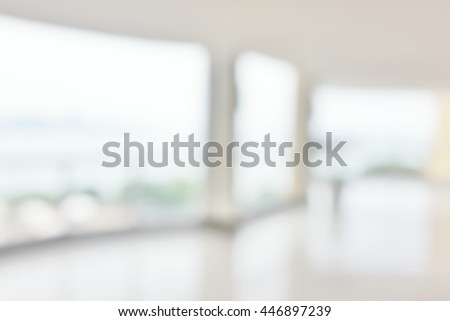Blur abstract background hotel hospital corridor. Defocused clean white lobby office glass with scenic sea view. - stock photo