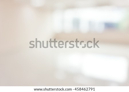 Blur abstract background hotel hospital corridor with big window. Defocused clean white lobby office wall.   Blurry view hall way in international airport. - stock photo