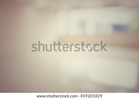 Blur abstract background hotel hospital corridor with big window. Defocused clean white lobby office wall. Blurry view hall way in international airport vintage tone. - stock photo