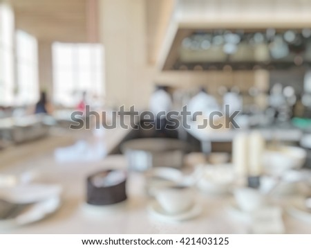 Blur abstract background luxury open kitchen in hotel restaurant facility showing chef cook working cooking service serving buffet breakfast dinner lunch meal on table tabletop food display - stock photo