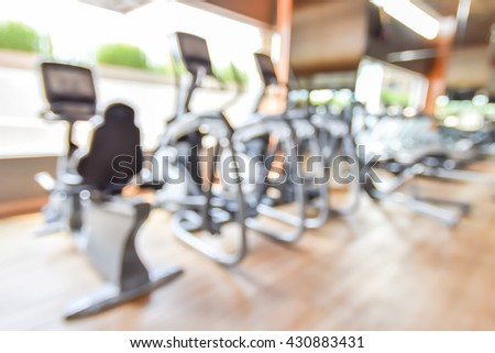 Blur abstract background modern fitness center lifestyle with health exercise equipment: Blurry perspective view gym facility service room: Empty gymnasium indoor space for diet, bodybuilding training - stock photo