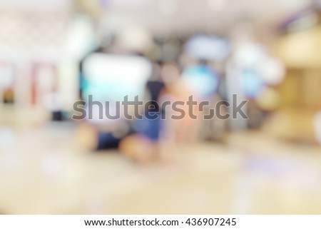 Blur abstract background of arcade game section in department store. Blurry coin-operated games center in mall. - stock photo