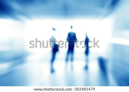 Blur abstract background of business people standing in building hall, blue theme