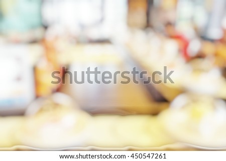 Blur abstract background of conveyor belt sushi in Japanese restaurant. Blurry sushi-go-around with japan food. Defocus sushi train running pass customers with bokeh effect. - stock photo