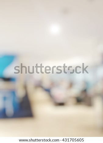 Blur abstract background of departure airport lounge area. Blurry view of passengers waiting in vip lounge to depart. Defocus image international airport interior. - stock photo