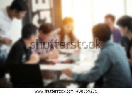 Blur abstract background of employees Young colleagues sitting at the business meeting in the office.vintage effect