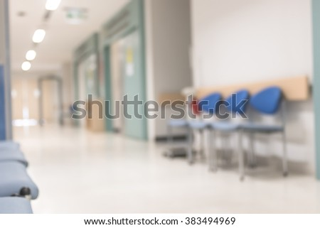 Blur abstract background of empty indoor hospital interior in hallway corridor lobby waiting area for patients, nurse, doctors and clinical staff circulation in clean, bright and hygienic environment  - stock photo