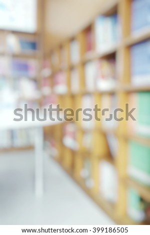 Blur abstract background of empty library with books on shelves in school or campus - stock photo