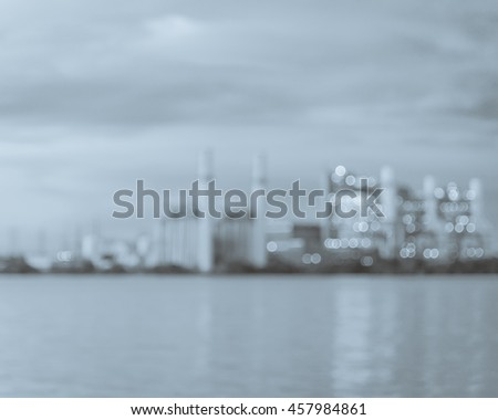 Blur abstract background of power plant at industrial park in San Antonio, US at twilight. The lake or reservoir in front provides cooling pond, recharged with treated wastewater for it. Black white. - stock photo