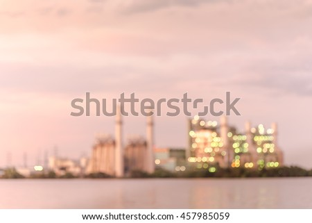 Blur abstract background of power plant at industrial park in San Antonio, US at twilight. The lake or reservoir in front provides cooling pond, recharged with treated wastewater for it.Vintage filter - stock photo