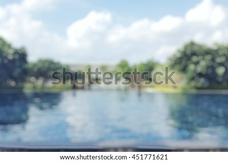 Blur abstract background resort hotel village swimming pool reflective water surface, Blurry blue cool sky tree around perspective view vacation summer party holiday relaxation pond with copyspace - stock photo